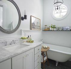 Rethink Design Studio - bathrooms - gray, vintage, antique, round, mirror, pale, gray, walls, clawfoot, tub, charcoal, gray, slate, tiles, floor, pale, gray, single, bathroom vanity, cabinet, calcutta, marble, countertop, glass, knobs, oil-rubbed bronze, sconces, coastal bathroom, beach cottage bathroom, bathtub shelf, gray mirror, round gray mirror, gray bathroom mirror,