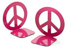 """Jonathan Adler """"Love Dove Peace Sign"""" Fuchsia Metal Bookend set of 2  ~  Stack your book collection between these metal bookends & add a punch of playfulness on any bookshelf or desk. Designed exclusively for Barnes & Noble by hands-on designer Jonathan Adler, this mod, pink set will keep your novels, thrillers & home-decorating books organized & at your fingertips. 12.95"""