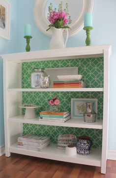 Glue wallpaper inside of your shelves to give an extra pop of color. | 27 DIY Ways To Give Your House A Quick Pick-Me-Up