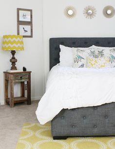 """""""I fought with the style of this room, but decided to go with Country Modern. Modern being the bed and pattern choices paired with the Country of a ruffled comforter and lots of distressed wood...along with the 'planked' walls, of course.""""   - HouseBeautiful.com"""