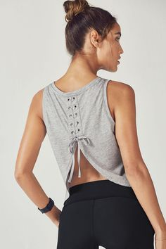 We added a sporty edge to your sexy open-back tank with a stylish lace-up design. Its soft jersey fabric makes this must-have layer perfect for light workouts a