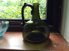 """Stunning hand blown antique wine bottle/ewar. 7"""" tall and 5"""" wide, snapped Pontic, hand folded handle and formed spout. Sits slightly back on itself. I have been informed that this is actually a shaft and globe wine bottle and may be circa 1640-1700 in date.   eBay!"""