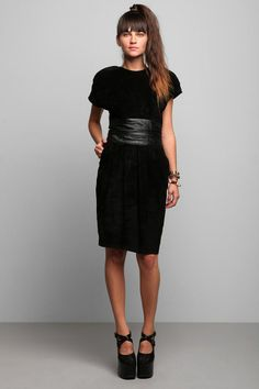 Wide black belt with black dress. The perfect wide waist belt to compliment this midi length dress.