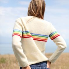 A crew neck pullover with delicate rib detail on hem and sleeve.    A classic mix of Monkstone Flock yarn in Natural Dorset colourway and bright Geelong yarns.