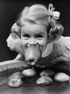 Bobbing for apples, a great Halloween time tradition.  (H. Armstrong Roberts)