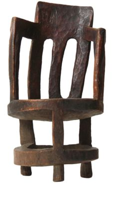 A hand-carved barrel-back armchair carved from a single tree section, Ethiopia