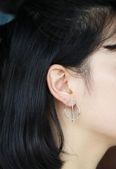 Unique round silver earrings.