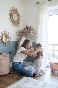 We have been lucky enough to partner with Ferne McCann to design and makeover Sunday's Playroom. Read all about the Inspiration behind the room as well as exclusive pictures from our photoshoot with Ferne, Sunday and photographer Chelsea White. Read all about it and how to create the look in our blog!    #playroomideas #kidsroominspiration Wall Cupboards, Painted Cupboards, Baby Nursery Decor, Girl Nursery, Contemporary Nursery Decor, Dress Up Corner, Teal Color Schemes, Half Painted Walls, Ferne Mccann