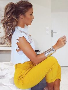 High bright colored pants with white frilly top