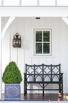 Simple narrow porch with bench and planter.  Banks Design Associates
