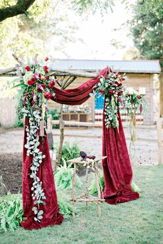 red velvet draped wedding ceremony arch