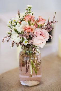 Blush jam jar wedding centerpieces