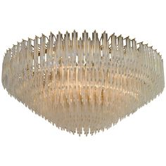 Midcentury Large Lucite Chandelier in a Cascading Circular Form | From a unique collection of antique and modern chandeliers and pendants  at http://www.1stdibs.com/furniture/lighting/chandeliers-pendant-lights/