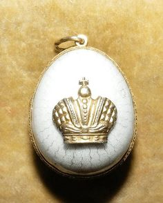 A late 19th century Faberge miniature silver gilt and enamel pendant egg the hinged gilt interior marked with Carl Faberge initials in Cyrillics, the egg having crown mount.   via Island Auction Rooms