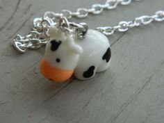 Kawaii Cow charm necklace by AcuteFox on Etsy