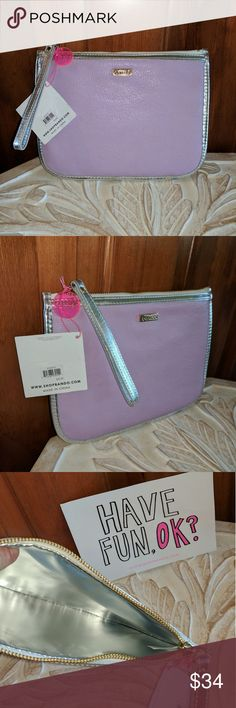 NWT Ban.do Fancy Clutch Wristlet in Lilac & Silver Add some glam to your look and prepare to be admired. The ban.do fancy clutch with wristlet lilac and silver adds zest and color to any look. Ban.do specializes in creating gifts and accessories that pack a stylish punch. Pop on a ban.do and prepare yourself for the zillions of compliments that you're going to get.  Metallic with textured leatherette, contrasting leatherette piping and wristlet (12.5 inch wristlet) Product Dimensions0.7 x 7…