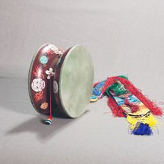 Wooden Damaru (Tibetan ritual drum) for Chod practice: diameter — 22 cm. This wooden damaru is perfect for Chöd (Chod, Tib.: གཅོད) practice. The skin of the drum dried and painted exactly as it did in ancient times. The mantras inside of the drum are painted traditionally by gold.  #dharma #dharmacraft #dharmacrafts #tibet #buddhism #tibetanbuddhism #damaru #tibetandrum #tibetanmmusic #buddhistdrum #buddhistmusic #ritualdrum #ritualmusic #chod #chodpa #chodpractice #choddrum