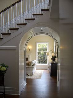 Love the archway under the stairs!