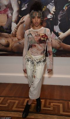 Chic: FKA Twigs, 28, looked pretty in her arty combo which showed a hint of her bra at the...