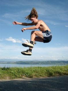 Footbag freestyle player performing a jumping trick.