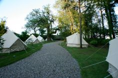 Ballyvolane Glamping - Luxury camping in a Country House Garden We now offer a 'glamping' option in the form of bell tents from May to September. We have luxurious 4M bell tents designed to accommodate 2 people and 5M tents which can accommodate 2 adults and up to 3 children. Our 'Glampers' will be given a 'glamping box' on arrival containing essentials such as matches, water, local Crinnaughtaun Apple juice, a jar of homemade chocolate cookies, maps of the estate and a torch and head-lamps.