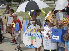 It's a RAINDROP Vocabulary Parade costume! Use an umbrella to hang drops from, label, presto, costume! See more ideas at DebraFrasier.com!