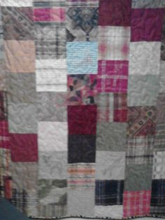 This quilt was made of decorative fabrics with animals embroidered on it for a client