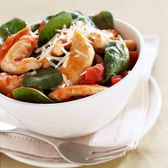 Basil-Tomato Chicken Skillet1 -1 1/4 pounds chicken breast tenderloins  Nonstick cooking spray  1/8 teaspoon salt  1/8 teaspoon ground black pepper  1 14 1/2 - ounce can no-salt-added diced tomatoes, drained  1/4 cup snipped fresh basil  1 9 - 10 - ounce package prewashed spinach  2 tablespoons finely shredded Parmesan cheese