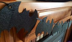 This 5 long black glitter bat banner is perfect for Halloween! Would be great to add to your window or mantle decor to get you in the Halloween