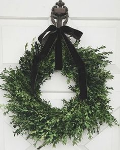 Brown velvet ribbon (that looks green in this pic) for Thanksgiving. (PSA: Trader Joe's boxwood wreaths are in!!) #nineandsixteenhome