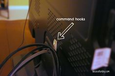 Never lay eyes on a mess of television cords again by hooking excess length to the back of your unit.