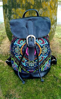 Check out this item in my Etsy shop https://www.etsy.com/listing/249494883/black-hmong-boho-leather-embroidery-bag