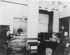 The photo of the Baltimore Central Police Department was taken about 1890. Notice the details, brass lamps and sconces, polished furniture with turned legs ... there's even a telephone on the desktop at the left.