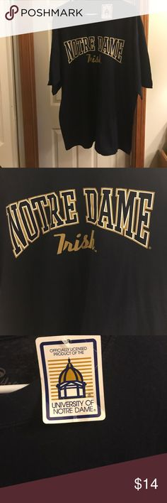NWT Notre Dame T-shirt New Notre Dame Irish Official t-shirt. Men's XL. Has original tag. Graphics on front. Cadre Shirts Tees - Short Sleeve