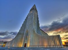 Hallgrímskirkja in Reykjavík is a Lutheran (Church of Iceland) parish church in Reykjavík, Iceland. At 73 metres (244 ft), it is the largest church in Iceland and the sixth tallest architectural structure in Iceland after Longwave radio mast Hellissandur, the radio masts of US Navy at Grindavík, Eiðar longwave transmitter and Smáratorg tower. The church is named after the Icelandic poet and clergyman Hallgrímur Pétursson (1614 to 1674), author of the Passion Hymns