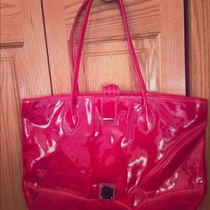 Dooney & Bourke tote Bright red, gently used, 2 small scratches as pictured. Looks great. Inside wallet pocket and cell phone pocket. Firm price. Dooney & Bourke Bags Totes