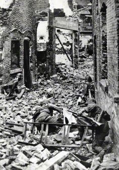 Japanese Marines advance among ruins of Shanghai town in October, 1937, China. That is one of the Battle of Shanghai which was fought between the National Revolutionary Army of the Republic of China and the Imperial Japanese Army of the Empire of Japan during the Second Sino-Japanese War.