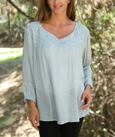 Love this Dusty Blue Eyelet Notch Neck Tunic - Women by Ananda's Collection on #zulily! #zulilyfinds Like the flow of this but in a darker color for Fall.