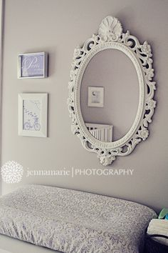 Wall above the dresser/changing table in her purple, grey and white nursery.