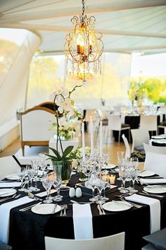 Black tablecloths might be my favorite; with all white dishes, and some red thrown in for the centerpieces maybe?