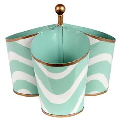 Perfect for stowing toiletries in your master bath or writing utensils in the home office, this charming hand-painted caddy showcases a lovely wave motif and...