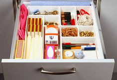 Junk drawer organized! There's no need to get rid of your junk drawer. But clear it out when it gets too crazy to be useful: Take everything out and pile similar items together. Get rid of things like expired coupons and spare keys that you can't identify. Buy a plastic tray with dividers, or repurpose baby wipes or cigar boxes, mint tins, and mesh bags. Group similar items together. This can be a fun job for children on a rainy day.