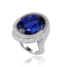 Chopard Red Carpet bague tanzanite http://www.vogue.fr/mode/shopping/diaporama/cadeaux-de-noel-bleu-nuit/10911/image/650933#chopard-red-carpet-bague-tanzanite