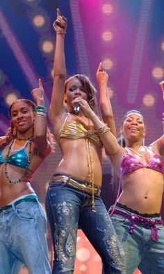 Rihanna Performs At Wembley In A Gold Bikini Top And Jeans, November 2005