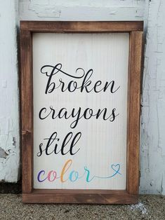"""This framed wood sign is an absolute favorite of mine and a much needed reminder for so many of us. Broken crayons still color Approximately 9"""" x 13"""" Off-white background with black lettering and pale gradient rainbow design. Rustic brown wood frame. distressed/weathered finish Custom orders welcome! All items I have for sale are crafted by hand, rather than mass produced as you would find in a store. Because of this, your piece may slightly vary from photos shown. My wood signs are often…"""