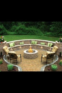 Fire pit with seat wall, a great way to nessle a fire pit into a sloped yard.