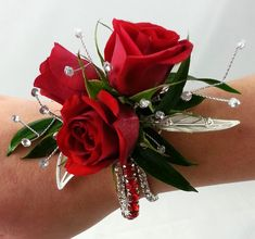 Red roses are dramatic against a fabulous rhinestone bracelet with pearled sprays and silver leaves. Red Corsages, Prom Corsage And Boutonniere, Flower Corsage, Corsage Wedding, Wedding Bouquets, Homecoming Flowers, Homecoming Corsage, Prom Flowers, Bridal Flowers