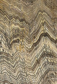 Hell's Canyon petrified wood. This rare wood, collected in the 1950s at a site now underwater at a dammed river on the Idaho / Oregon border, had dry rot and was compressed before petrification, creating its characteristic herringbone pattern.