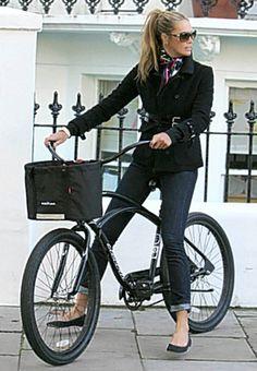 Elle McPherson with bike