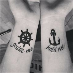 An anchor and wheel couple tattoo. As these two go together they are a perfect fit for couple tattoos. There are also words etched on the e wrists saying quotes that also reflect what the symbols are for.
